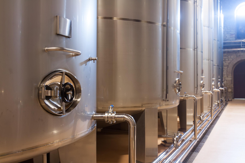 modern stell barrels in winery
